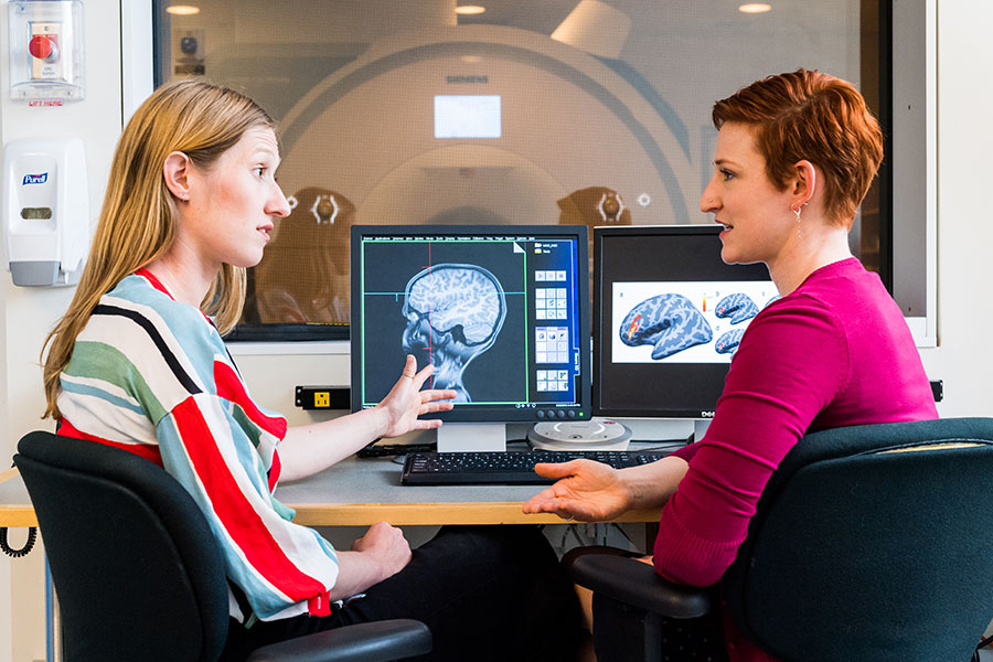 Two McGovern scientists collaborate on research in the Martinos Imaging Center.