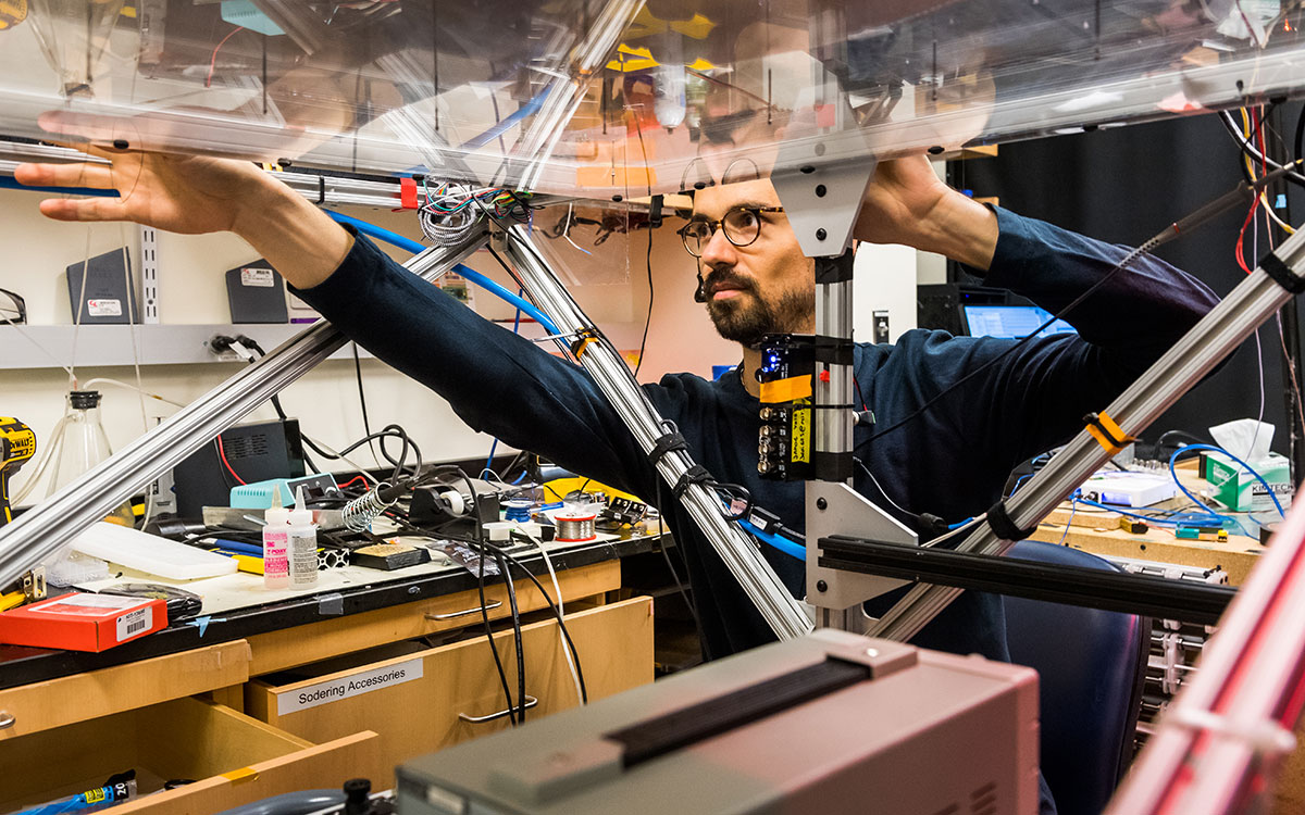 postdoc works on rig in lab