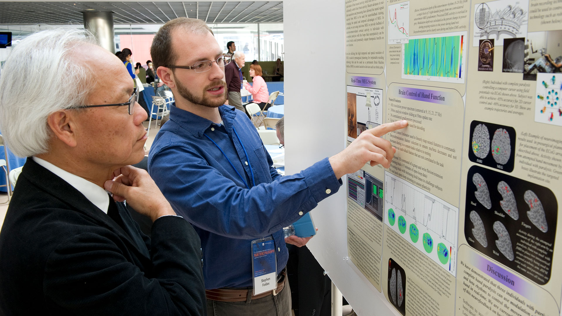 Researcher presents data at poster presentation